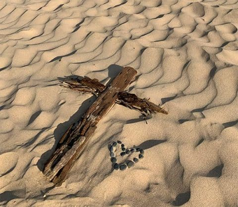 Wooden Cross in the sand at Lake Michigan